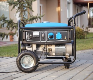 Gasoline powered portable generator at home .
